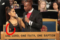 Bishop Charles H Ellis getting to grips with Ariana Grande at Aretha Franklin's funeral