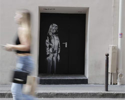 Banksy work painted on emergency doors at the Bataclan in Paris