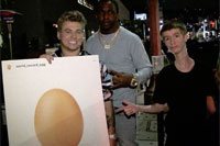 Supreme Patty holding a world_record_egg placard leaving Poppy in West Hollywood with Daddy Long Neck and Wide Neck