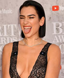 Dua Lipa poking her tongue out on the 39th Brit Awards red carpet