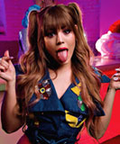 Danna Paola poking her tongue on the Mala Fama music video set