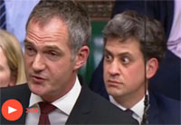 Former Labour leader Ed Milliband distracted while Conservative MP Nick Boles speaks