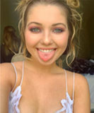 Sammi Hanratty poking her tongue out in a lacy camisole