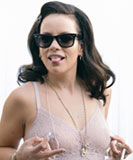 Lily Allen poking her tongue out while pinching her nipples in a sheer lace bodysuit